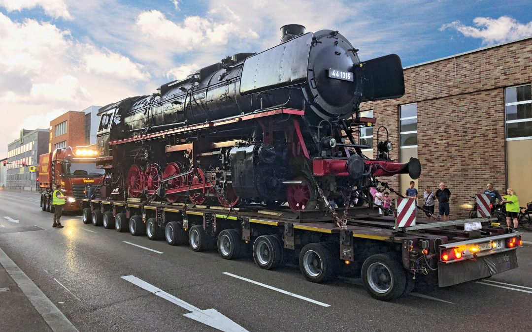 A freight locomotive moves into the museum